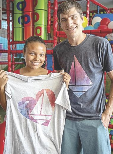 Josh Scheffler poses with the child he sponsored in Columbia, Margenys, through the Children International humanitarian organization.