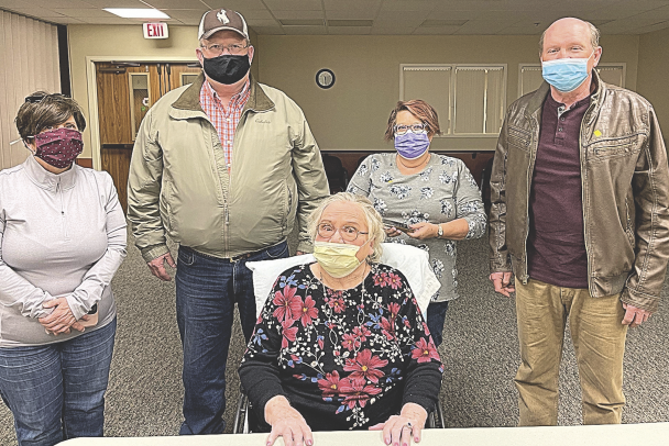 courtesy photo     Norma Hessenthaler sits were her family, who visited her in the New Horizons Care Center Wednesday morning. From left to right behind her stands Erin Hessenthaler, Paul Hessenthaler, Stacy Hessenthaler and Kent Hessenthaler.