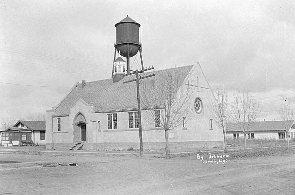 UW archive photo      This photo from the University of Wyoming American Heritage Center collection shows the Lovell Methodist Episcopal Church shortly after its construction in 1921-22. Notice the wooden steps to the front door. A Sunday school wing was added in the 1950s.
